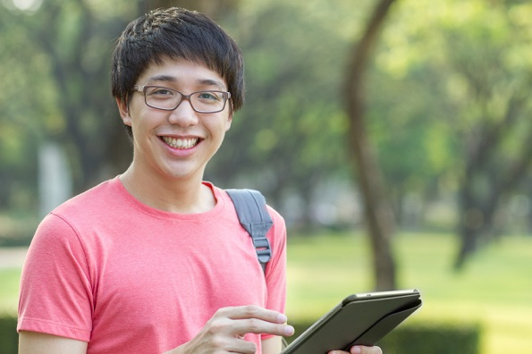 Asian student using tablet